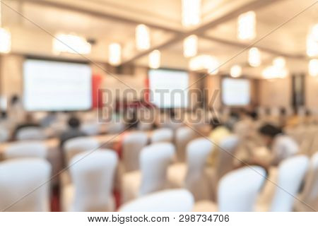 Seminar Or Townhall Meeting Blur Background In Hotel Conference Room With Audiences  And Speaker Pod
