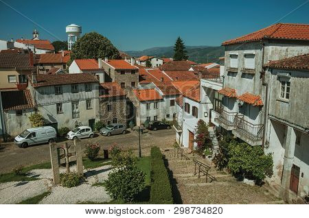 Belmonte, Portugal - July 16, 2018. Old Houses With Worn Plaster In Small Square On Slope At Belmont