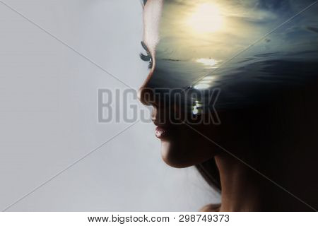 Psychoanalysis And Meditation, Concept. Profile Of A Young Woman And Sunset Over The Ocean, Calm And