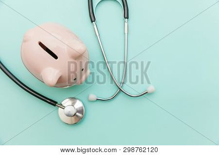 Medicine Doctor Equipment Stethoscope Or Phonendoscope And Piggy Bank Isolated On Trendy Pastel Blue