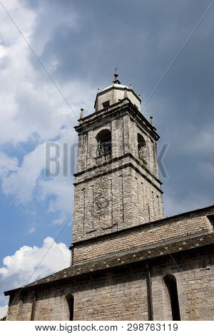 Basilica Of San Giacomo Framed By A Side Street In Bellagio, Lake Como, Italy, 27th August 2011