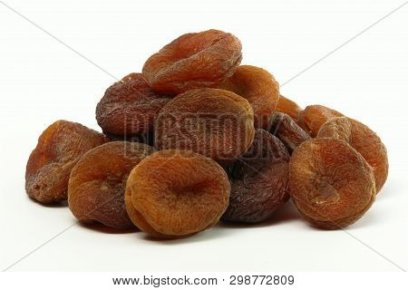 Stack Of Sundried Apricots (isolated On White Background)