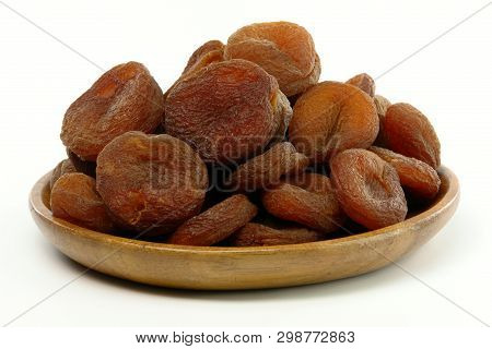 A Plate Of Sundried Apricots On White Background