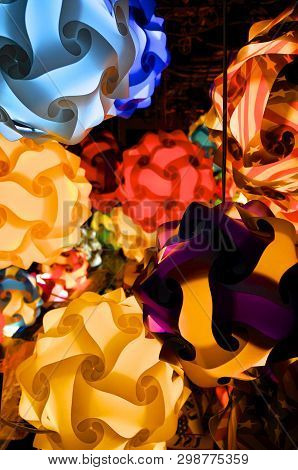 Close Up Picture Of Many Colored Puzzle Lamps Hanging From The Ceiling Of A Shop In Quincy Market In
