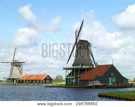 Well Preserved Traditional Dutch Windmills And Houses In Zaanse Schans, Historic Site In Zaandam, Ne