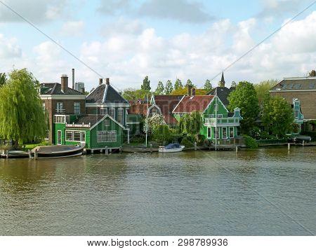 Impressive Dutch Town On The Zaan Riverbank, Historic Site In Zaanstad, Netherlands