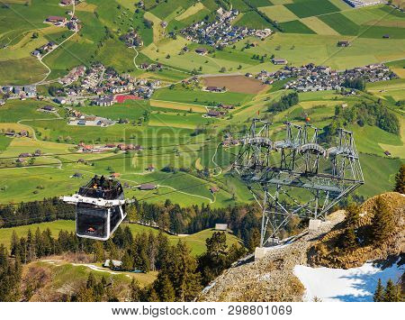 Mt. Stanserhorn, Switzerland - May 7, 2016: People In A Gondola Of The Stanserhorn Cabrio Aerial Cab