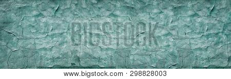 Dark Turquoise Cracked Concrete Wall Wide Texture. Weathered Cement Surface Panoramic Retro Backgrou