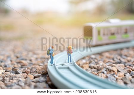 Miniature People : Couple Backpacker Walking On The Railway , Travel Concept