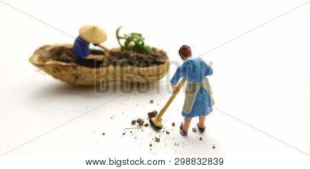 Conceptual Illustration, Keep Struggle, Mini Figure Man Farming At Limited Area, Peanut Skin, With W