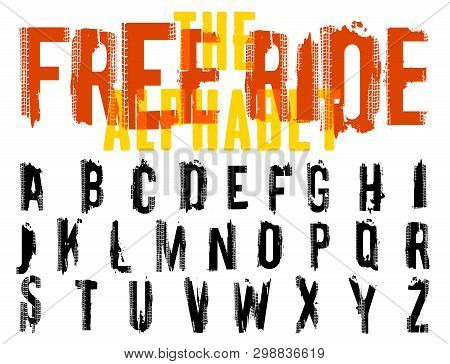 Free Ride. Grunge Tire Letters. Off Road Lettering In A Black Color Isolated On White Background. Ed