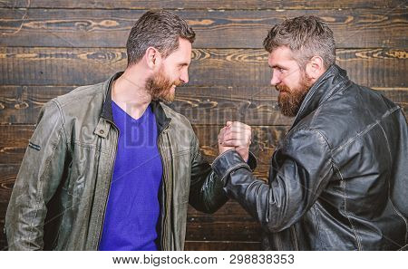 Strong Handshake. Friendship Of Brutal Guys. Handshake Symbol Of Successful Deal. Approved Business