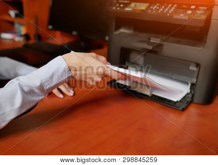Paper In Printer. Sets The Paper Stack In The Laser Printer