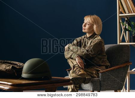 Close Up Portrait Of Female Soldier. Woman In Military Uniform Waiting For Coming Home. In Doctors C