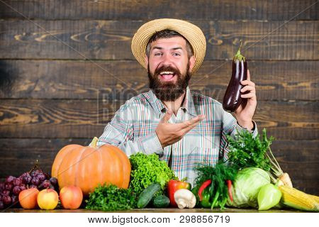 Grow Organic Crops. Homegrown Organic Food. Man With Beard Wooden Background. Farmer With Organic Ve
