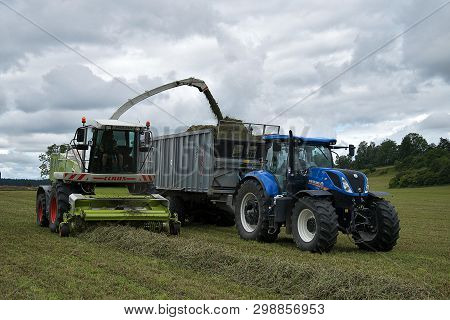 Svitavy, Czech Republic - 20.4.2019: Forage Harvest. The New Holland Tractor And Claas Are Harvested