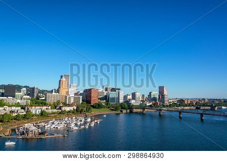 Willamette River And Cityscape Of Portland, Oregon On A Beautiful Clear Day