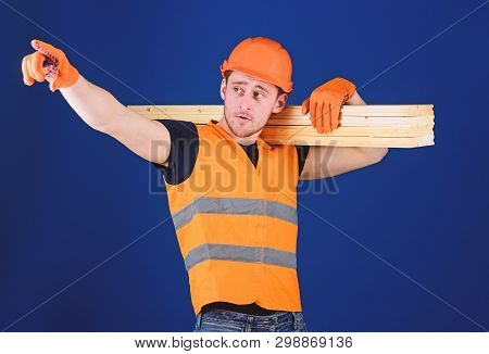 Wooden Materials Concept. Carpenter, Woodworker, Strong Builder On Busy Face Carries Wooden Beam On