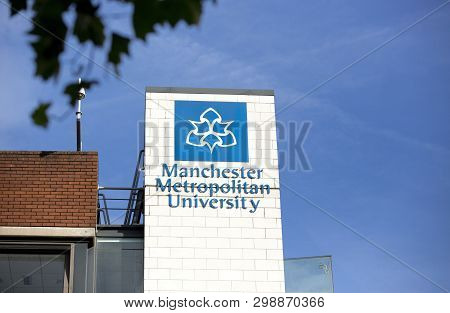 Manchester, Greater Manchester, Uk, October 2013, A View Of Signage For Manchester Metropolitan Univ