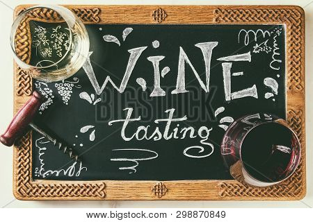 Variety Of Wine. Red And White Wine In Old Fashion Glasses, Corkscrew, Decorative Chalkboard With Ha