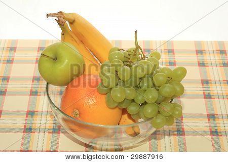Fresh Green Grapes, Apple, Banana And Grapefruit On A Table