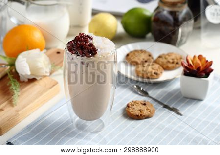 Red Bean Coconut Milk Tea In A Clean Glass And A Dish Of Cookies