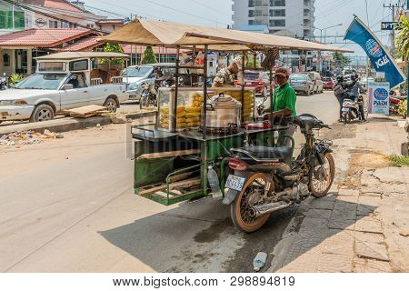 Sihanoukville, Cambodia - March 15, 2019: Ambulant Vendor Sells Corn On The Cob From His Tricycle Ki