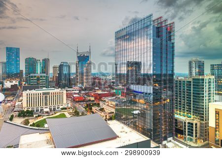 Nashville, Tennessee, USA downtown city skyline rooftop view at dusk.