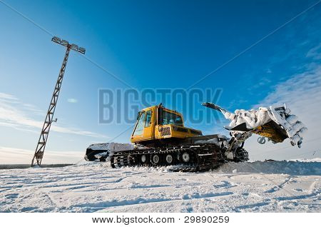 Snowcat On Top Of The Mountain