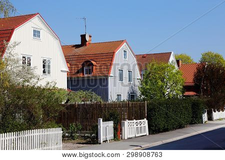 Block Of Two Story Single Family Wooden Houses With Mansard Roofs Erected Duringthe 1920s Era.