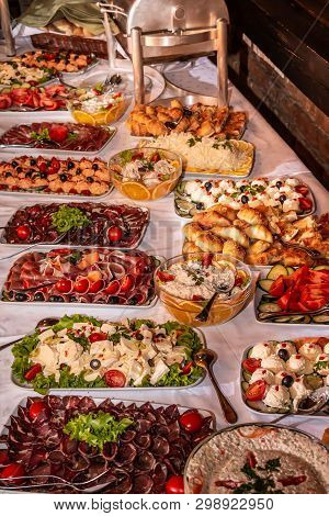 Buffet Table With Cold Snacks And Delicious Appetizers. Catering Food Event Banquet Table.