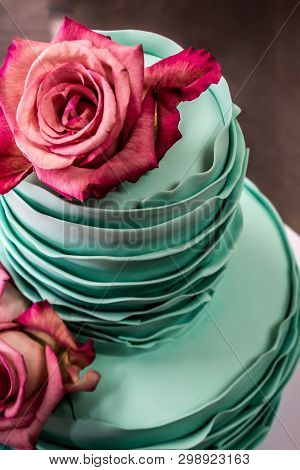 Fondant Two Tiered Birthday Cake Decorated With Roses. Top View, Close Up.