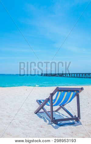 Beach Chairs And Bridges With Sea And Bright Sky