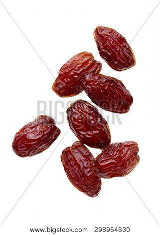 Close up of a dried date fruit over a white background.
