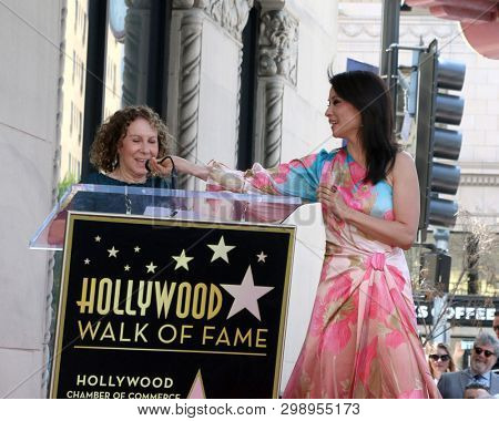 LOS ANGELES - MAY 1:  Rhea Perlman, Luy Liu at the Lucy Liu Star Ceremony on the Hollywood Walk of Fame on May 1, 2019 in Los Angeles, CA