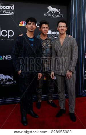 LAS VEGAS - MAY 1:  Joe Jonas, Nick Jonas and Kevin Jonas at the 2019 Billboard Music Awards at MGM Grand Garden Arena on May 1, 2019 in Las Vegas, NV