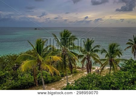 Aerial View Off Of The Old Rail Bridge In Bahia Honda State Park, Looking Out Into The Crystal Blue Waters  Of The Florida Keys With Palm Trees And Bicyclist On The Shore. poster