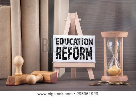 Education Reform Concept. Sandglass, Hourglass Or Egg Timer On Wooden Table Showing The Last Second