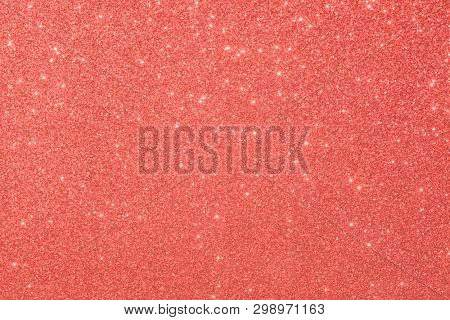 red glitter macro background. Close-up shot of glittery texture.