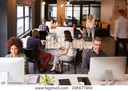 Elevated view of creative business colleagues working in a busy office