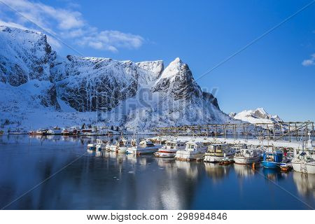Beautiful Pier In The Sea In Winter, Good Sunny Weather, High Mountains And The Sea Behind The Pier,