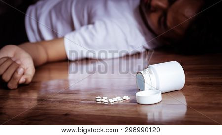 Depression Man Committing Suicide By Overdosing On Medication. Close Up Of Overdose Pills From Plast