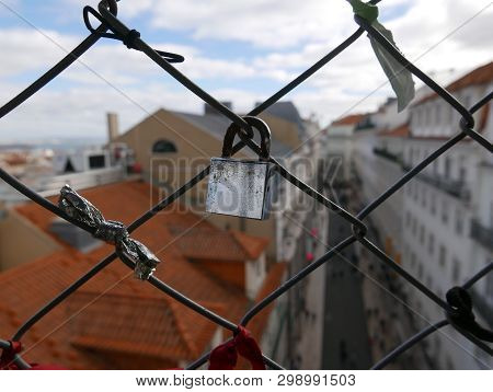 Padlocks On Ancient Elevator Santa Justa In Lisbon, Love Locks Are A Symbol Of Love And Commitment
