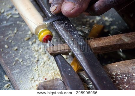Skilled Village Artisan Busy In Making A Wooden Toy At Madhu Vana Near Bengaluru, Karnataka, India,