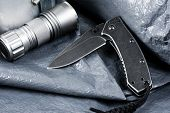 stainless steel pocketknife with blackwash finish on blade and handle poster