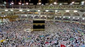 MECCA,SAUDI ARABIA-SEPTEMBER 16, 2016: Muslim piligrims  going around the Kaaba in the Al-Haram Mosque in Mecca, the largest mosque in the world