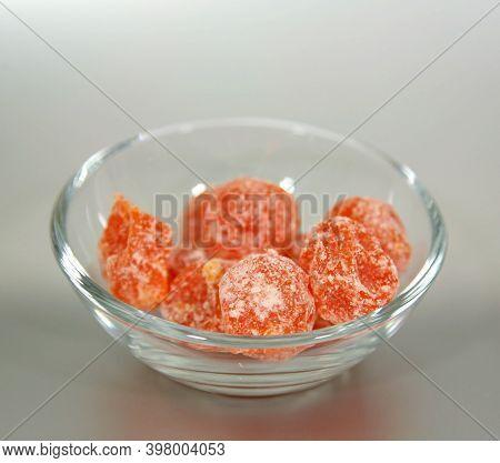 Candied Kumquat In Sugar In A Glass Cup