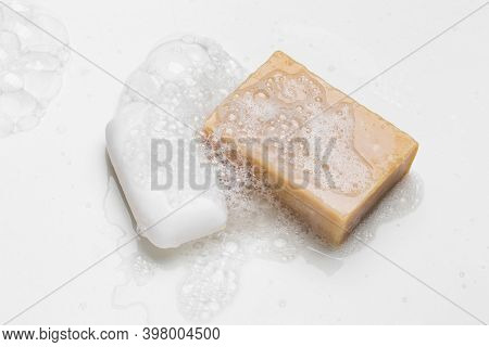 Soap Bar And Foam On White Background