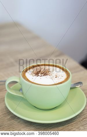 Green Cup Of Coffee Latte On Wooden Background, Close Up Of Art Coffee In Morning.