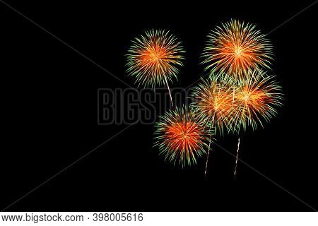 Colorful Fireworks Celebration, New Year Celebration Fireworks And The Black Sky Background.